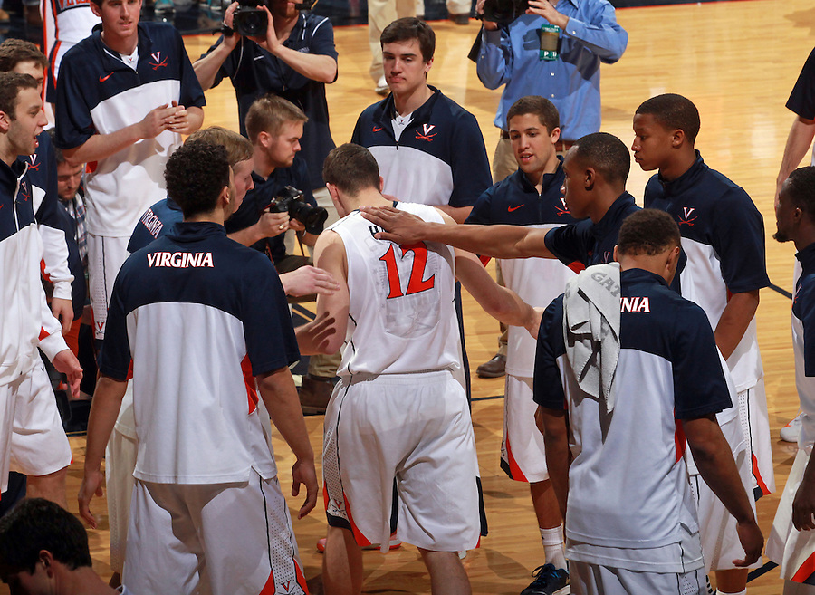 Senior Virginia guard Joe Harris (12) goes through the huddle at home one last time before an NCAA basketball game Saturday March 1, 2014 in Charlottesville, VA. Virginia defeated Syracuse 75-56.