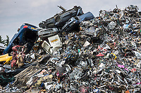Metal recycling of cars, autos and other scrap metal to avoid environmental pollution in England