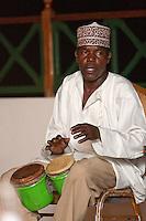 Zanzibar, Tanzania.  Member of Twinking Star Taarab Musical Group, a part of the Nadi Akhwan Safaa, Playing the Drums.