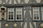 Exterior facade of building showing timber decoration and statue of Mary and Jesus. Schramberg, Black forest, Germany.