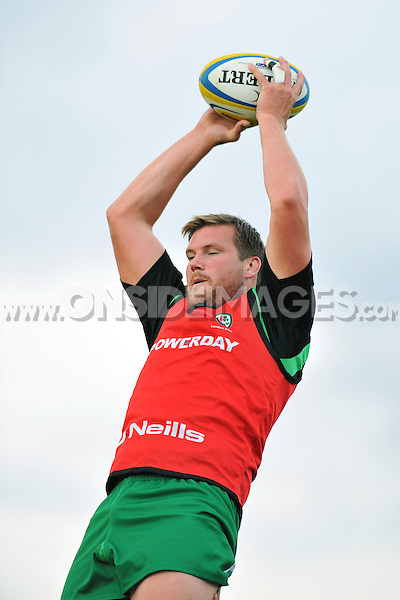 Nic Rouse wins lineout ball during the pre-match warm-up. Pre-season friendly match, between London Irish and Bristol Rugby on August 22, 2014 at Hazelwood in Middlesex, England. Photo by: Patrick Khachfe / JMP