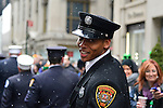 March 16, 2013 - New York, NY, U.S. - As it snows, a member of the Richmond Fire Department marches in the 252nd annual NYC St. Patrick's Day Parade. Thousands of marchers show their Irish pride, as they march up Fifth Avenue, and over a million people watch and celebrate.