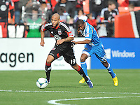Kyle Porter (19) of D.C. United controls the ball against Raymon Gaddis (28) of the Philadelphia Union. The Philadelphia Union defeated D.C. United 3-2, at RFK Stadium, Sunday April 21, 2013.