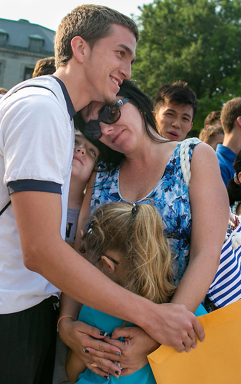 "UNITED STATES - JULY 1 - Prospective plebe Xebastian Aguilar, from Miami, Fla., hugs his mother, Raquel Rylands, brother, Seth Rylands, 10, and sister, Slynne Rylands, 8, before leaving them to begin Induction Day at the U.S. Naval Academy, Wednesday, July 1, 2015, in Annapolis, Md. More than 1,100 young men and women reported for ""I-Day,"" where they received haircuts, medical examinations, new uniforms and instructions on how to salute before taking an oath of office to become members of academy's newest class. (Photo By Al Drago/CQ Roll Call)"