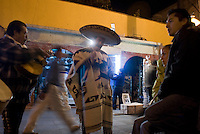 A couple hire a Mariachi band to perform to them in Plaza Garibaldi where Mariachis gather to work in Mexico City, Friday, Jan. 4, 2008
