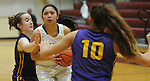Ketchikan's AJ Dela Cruz drives through a pair of Latrop defenders in their Dimond Lady Lynx Prep Shootout basketball game Friday, February 10, 2017.  Photo for the Daily News by Michael Dinneen