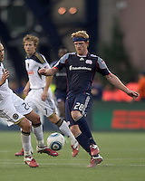 New England Revolution midfielder Pat Phelan (28) passes the ball. In a Major League Soccer (MLS) match, the Philadelphia Union defeated the New England Revolution, 3-0, at Gillette Stadium on July 17, 2011.