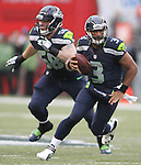 Seattle Seahawks quarterback Russell Wilson (3) scrambles against the Denver Broncos during the first quarter at CenturyLink Field on August 14, 2015 in Seattle Washington.  The Broncos beat the Seahawks 22-20.  © 2015. Jim Bryant Photo. All Rights Reserved.