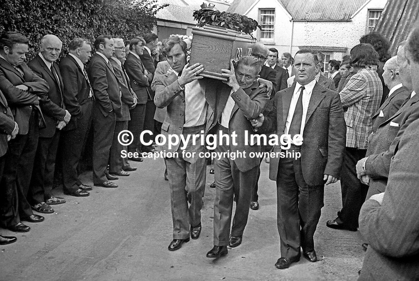 Funeral cortege of Brian McCoy, trumpeter, one of three members of the Miami Show Band, who died in a UVF attack as the band was travelling back to Dublin after appearing in Banbridge, leaves from his family home in Caledon, Co Tyrone, N Ireland, 2nd August 1975. 197508020595a<br /> <br /> Copyright Image from Victor Patterson, 54 Dorchester Park, Belfast, UK, BT9 6RJ<br /> <br /> t1: +44 28 9066 1296 (from Rep of Ireland 048 9066 1296)<br /> t2: +44 28 9002 2446 (from Rep of Ireland 048 9002 2446)<br /> m: +44 7802 353836<br /> <br /> e1: victorpatterson@me.com<br /> e2: victorpatterson@gmail.com<br /> <br /> www.victorpatterson.com<br /> <br /> IMPORTANT: Please see my Terms and Conditions of Use at www.victorpatterson.com