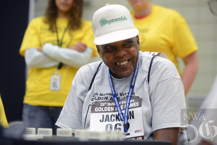 STAFF PHOTO SAMANTHA BAKER &yen; @NWASAMANTHA<br /><br />Randle Jackson (Cq), from central Texas, smiles at his competitor while playing dominos Sunday, June 29, 2014, at the HPER building on campus in Fayetteville for the 28th annual National Veterans Golden Age Games. Dominos, checkers and table tennis were events scheduled for Sunday. Monday's events will include horseshoes, bowling, swimming, checkers, dominos, and nine-ball. Badminton will also be played as an exhibition event.