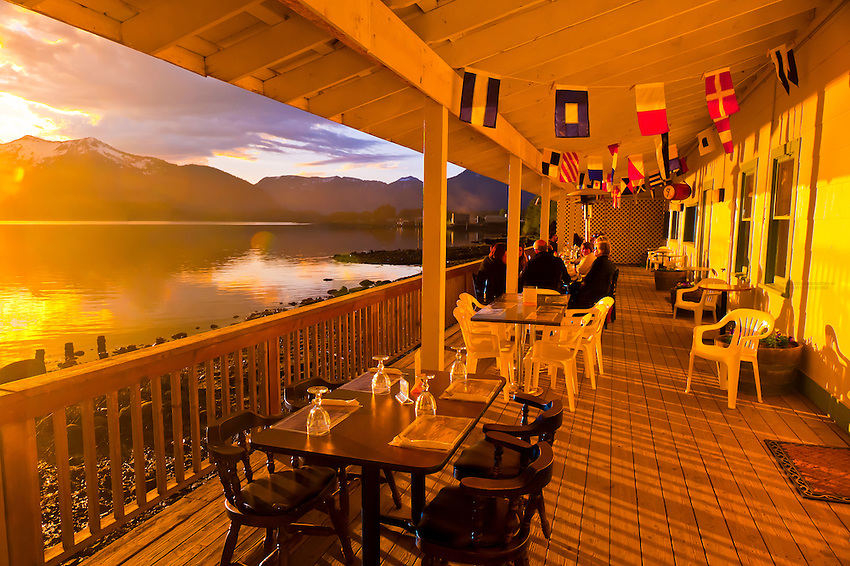 Eating dinner outside a lovely evening at the Beachcomber Inn, near Petersburg, Southeast Alaska USA