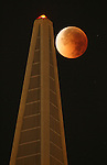 The moon turned a yellowish brown to a blood red during Tuesday night's total lunar eclipse as it passed by the TransAmerican Pyramid in San Francisco. The moon's surface darken as the earth's shadow creeped across it to create a partial eclipse from just before 1:51am (PST) with the total eclipse visible one hour later...8/28/07.{Photographed by Frederic Larson}