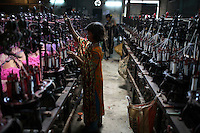 Child working in a textile factory in Dhaka. It is common in Bangladesh for children of poor parents to work in various hazardous and labour-intensive workplaces to support their families. The average child labourer earns between 400 to 700 taka (1 USD = 70 taka) per month, while an adult worker earns up to 5,000 taka per month..