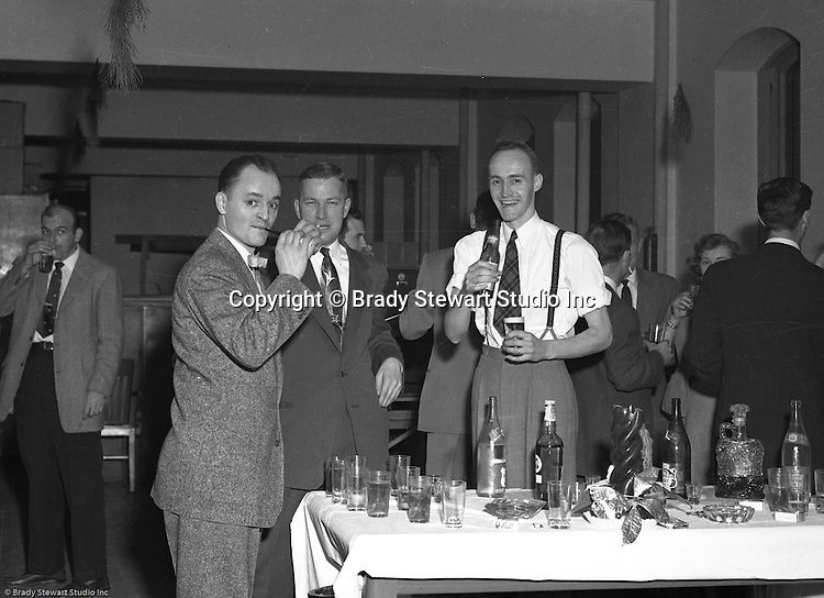 Pittsburgh PA:  Brady Stewart Studio annual Christmas party for customers - 1952.  Brady Stewart Jr (left) talking with a client from Ketchum McLeod and Grove and Bob Mitchell, an artist that rented space at 725 Liberty Avenue. Pittsburgh PA:  Brady Stewart Studio annual Christmas party for customers - 1952.  Employees of local advertising agencies and art studios along with corporate clients attended.