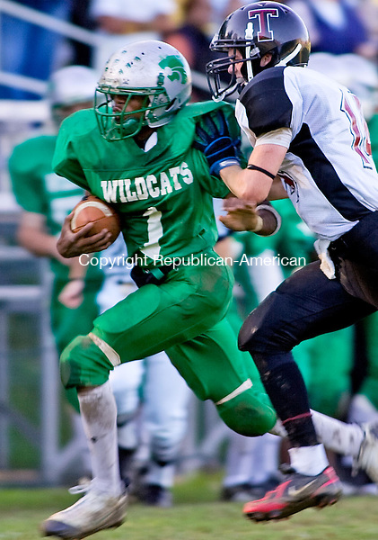 WATERBURY, CT - 04 OCTOBER 2008 -100408JT12--<br /> Wilby's Devon Pruden gets pushed out of bounds by Torrington's Alex Pullium during Saturday's game at Wilby. Torrington won, 38-48.<br /> Josalee Thrift / Republican-American