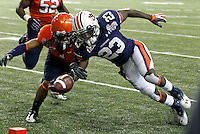 ATLANTA, GA - DECEMBER 31: Onterio McCalebb #23 of the Auburn Tigers is tackled by Demetrious Nicholson #1 of the Virginia Cavaliers during the 2011 Chick Fil-A Bowl at the Georgia Dome on December 31, 2011 in Atlanta, Georgia. Auburn defeated Virginia 43-24. (Photo by Andrew Shurtleff/Getty Images) *** Local Caption *** Demetrious Nicholson;Onterio McCalebb
