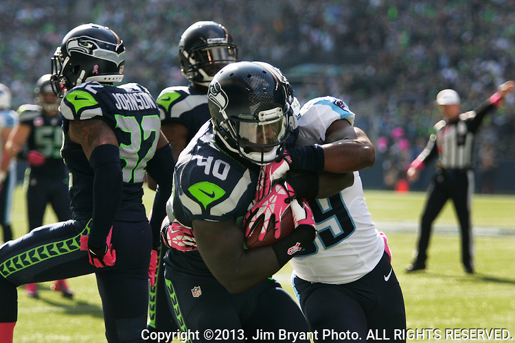Seattle Seahawks fullback Derrick Coleman (40) returns a Tennessee Titians fumble at CenturyLink Field in Seattle, Washington on October 13, 2013. The Seattle Seahawks beat the Titians  20-13.   ©2013. Jim Bryant Photo. All Rights Reserved.