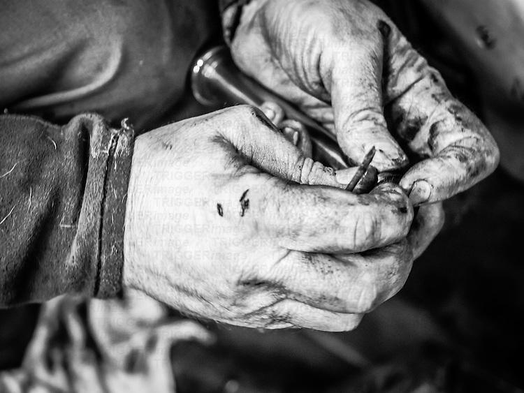 Mechanics dirty hands with pushrod