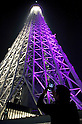 May 24, 2012, Asakusa, Japan - A visitor takes a picture of the Tokyo Skytree by Nintendo SD?s camera...Tokyo Skytree has two lighting styles, the concept of the design is based on Japanese  aesthetic &quot;Miyabi&quot; in purple and blue &quot;Iki&quot; represents the essence of Kokoroiki. The tower opened to the public on May 22nd 2012 and at 634m is the worlds' 2nd tallest building and the worlds' tallest tower.