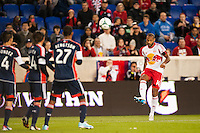 Thierry Henry (14) of the New York Red Bulls takes a free kick. The New York Red Bulls defeated the New England Revolution 4-1 during a Major League Soccer (MLS) match at Red Bull Arena in Harrison, NJ, on March 20, 2013.
