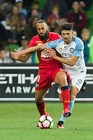 Melbourne, 28 October 2016 - TAREK ELRICH (21) of Adelaide and JOSHUA ROSE (3) of Melbourne City fight for the ball in the round 4 match of the A-League between Melbourne City and Adelaide United at AAMI Park, Melbourne, Australia. Melbourne won 2-1 (Photo Sydney Low / sydlow.com)