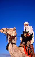 Camel Rider at the Douz Desert Festival..Tunisia. North Africa.
