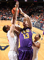Jan. 2, 2011; Charlottesville, VA, USA; LSU Tigers forward Eddie Ludwig (13) shoots between Virginia Cavaliers forward Will Regan (4) and Virginia Cavaliers guard Mustapha Farrakhan (2) during the game at the John Paul Jones Arena. Virginia won 64-50. Mandatory Credit: Andrew Shurtleff-