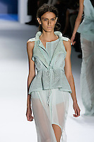 Erjona Ala walks runway in a Mint perforated super pique peplum vest and chiffon carved hem skirt by Vera Wang, for the Vera Wang Spring 2012 collection, during Mercedes-Benz Fashion Week Spring 2012.