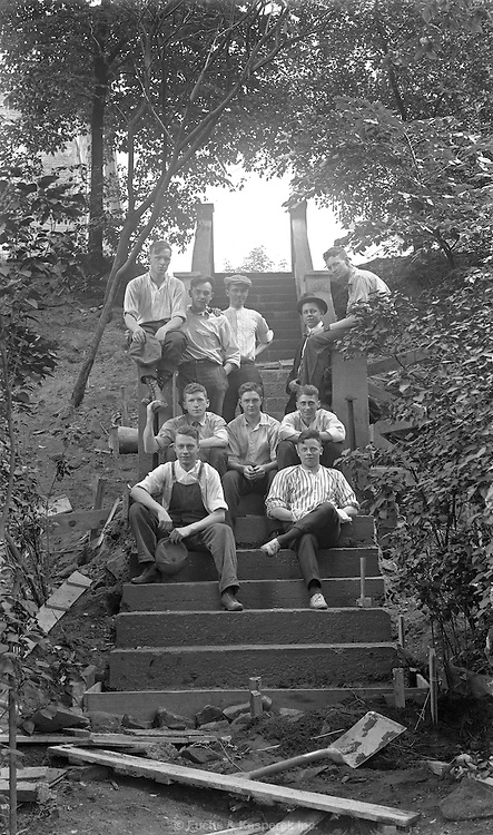 A group of young me pose for the camera while working on constructing a staircase. Case Western University. Circa 1920.