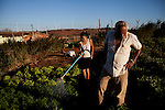 CAETITE, BRAZIL - OCTOBER 25, 2013:<br /> Florisvaldo Silva, 83, left, with his daughter-in-law Maria da Silva, and their family agreed to be paid $250 a month to permit Renova Energia with wind turbines on their 46-acre land. A string of wind-turbine parks, in the municipal of Caetite, are being erected in the windiest stretches of Bahia state, Brazil, on Friday, Oct 25, 2013. <br /> (Photo by Lianne Milton/For The Washington Post