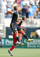 Fred #7 of the Philadelphia Union of Toronto FC gets a high ball away from Nana Attakora #3 during an MLS match at PPL stadium in Chester, PA. on July 17 2010. Union won 2-1 with a last minute penalty kick goal.