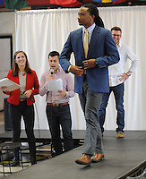 NWA Democrat-Gazette/ANDY SHUPE<br /> Lionel Davis II (center), a University of Arkansas senior from Little Rock, models a business-casual outfit alongside Will McCarley (right), Tuesday, Feb. 14, 2017, as Maggie Benton (left), Associated Student Government Student Body vice president, and Connor Flock, Associated Student Government Student Body president, emcee the event during the &quot;Dress for Success&quot; fashion show hosted by the university's Career Development Center and Associated Student Government at the Arkansas Union on the university campus in Fayetteville. Student models showcased clothing available from Boss Hog Outfitters Career Closet which provides students with free use of professional business attire for career fairs or formal events.
