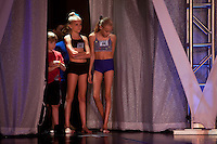 New York, NY - July 05, 2013 : Luke Spring, 10, stands beside Rylie Parker, 10, and Grace Skowron, 9, right, during rehearsals for the Junior Gala at the New York City Dance Alliance National Summer Workshop held at the Sheraton New York Times Square Hotel in New York, NY on July 05, 2013. Luke Spring, a dance prodigy from Studio Bleu Dance Center in Ashburn, VA, has performed on the Tonys, Ellen, So You Think You Can Dance and The Ford Gala. His sisters Cami Spring, 20, and Lucy Spring, 18, are both award winning dancers. (Photo by Melanie Burford/Prime for The Washington Post)
