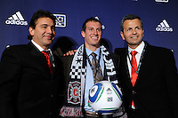 Chicago Fire draft pick Corben Bone with head coach Carlos de los Cobos (L) and technical director Frank Klopas during the MLS SuperDraft at the Pennsylvania Convention Center in Philadelphia, PA, on January 14, 2010.