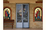 Travel stock photo of an Entrance into Archangelos Michail orthodox church in Parekklisia village near Limassol in Cyprus Horizontal