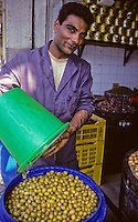 Tunisia.  Tunis Medina.  Wholesale Grocer with Olives.