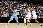 27 March 2015: North Carolina's Stephanie Mavunga (1) is defended by South Carolina's A'ja Wilson (22) and Alaina Coates (center). The University of North Carolina Tar Heels played the University of South Carolina Gamecocks at the Greensboro Coliseum in Greensboro, North Carolina in a 2014-15 NCAA Division I Women's Basketball Tournament regional semifinal game. South Carolina won the game 67-65.