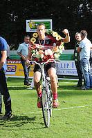 KAATSEN: BITGUM: Hoofdklasse kaatsen, winnaars Martijn Olijnsma, Marten Feenstra en Pier Piersma, Marten Feenstra op gewonnen fiets, ©foto Martin de Jong