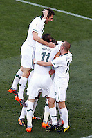 The Slovenia team celebrate the opening goal against USA scored by Valter Birsa