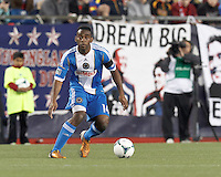 Philadelphia Union midfielder Amobi Okugo (14) controls the ball and looks to pass.In a Major League Soccer (MLS) match, the New England Revolution (blue/red) defeated Philadelphia Union (blue/white), 2-0, at Gillette Stadium on April 27, 2013.