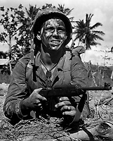 Marine awaits signal to go ahead in battle to recapture Guam from Japs.  July 1944. Lt. Paul Dorsey. (Navy)<br /> Exact Date Shot Unknown<br /> NARA FILE #:  080-G-475159<br /> WAR &amp; CONFLICT BOOK #:  1194