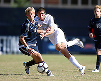 Andy Riemer #20 of Georgetwn University crashes into Kyle Soroka #5 of Villanova University during a Big East match at North Kehoe Field, Georgetown University on October16 2010 in Washington D.C. Georgetown won 3-1.