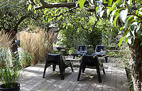An additional decked terrace has been created in the centre of the garden beneath the shade of surrounding trees