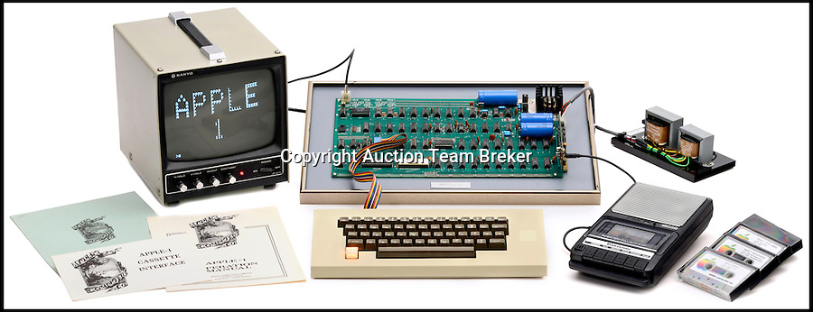 BNPS.co.uk (01202 558833)<br /> Pic: ATBreker/BNPS<br /> <br /> Humble beginnings of a billion pound business... <br /> <br /> An incredibly rare Apple 1 computer, the 46th ever built and one of just a handful of Apple 1's in existence.<br /> <br /> Dubbed the &quot;world's best&quot; Apple 1, it has been put up for sale for &pound;500,000.<br /> <br /> Included in the sale is a picture of the early production line in Steve Job's bedroom dating from 1976.