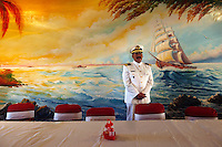 Bolivian Navy Captain Hernan Crespo, master of scuba, stands in the dining room of the the Tiquina Naval Base, on Lake Titicaca on the day they mourn the loss of their ocean to Chile in the War of the Pacific. Bolivia lost what is now northern Chile in a war over nitrates leaving Bolivia without access to the ocean.