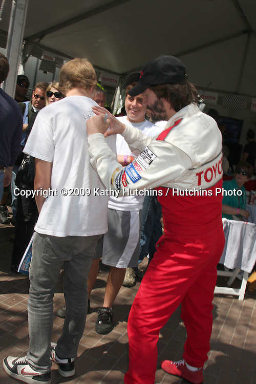 Keanu Reeves signing autographs at the  Toyota Pro/Celeb Race Day on April 18 ,2009 at the Long Beach Grand Prix course in Long Beach, California..©2009 Kathy Hutchins / Hutchins Photo....                .