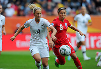 Katie Hoyle (l) of team New Zealand and Fara Williams of team England during the FIFA Women's World Cup at the FIFA Stadium in Dresden, Germany on July 1st, 2011.