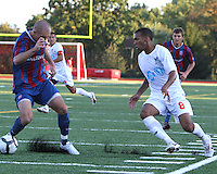 Shaun Pejic #4 of Crystal Palace Baltimore loses the ball through his legs to Matt Watson #8 of the Carolina Railhawks during an NASL match at Paul Angelo Russo Stadium in Towson, Maryland on September 18 2010.Carolina won 4-2.