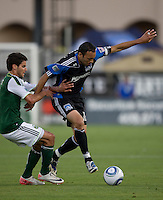 Ramiro Corrales of Earthquakes controls the ball away from Timber defender during the game at Buck Shaw Stadium in Santa Clara, California on August 6th, 2011.   San Jose Earthquakes and Portland Timbers tied 1-1.