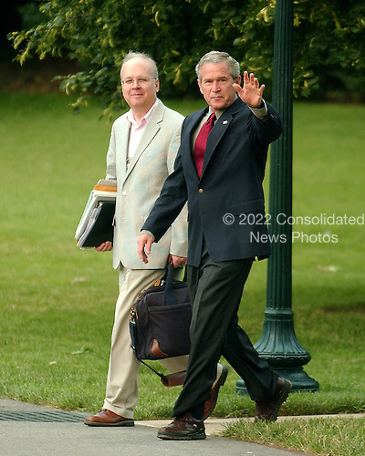 Washington, D.C. - July 4, 2006 -- United States President George W. Bush, accompanied by senior advisor Karl Rove, waves to the cameras as he prepares to depart the south lawn of the White House via Marine One to visit the United States Army Special Command in Fort Bragg, North Carolina in Washington, D.C. on July 4, 2006.  The President was visiting Fort Bragg to celebrate Independence Day..Credit: Ron Sachs - Pool